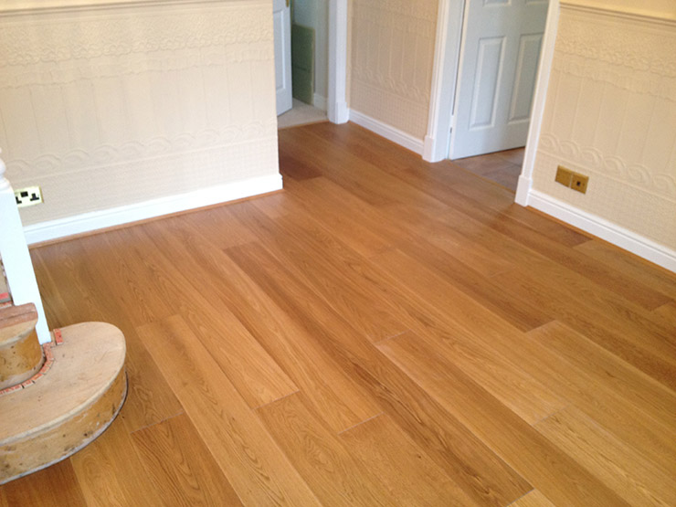 Laminate flooring hallway laminate flooring installation for Carpet and laminate flooring