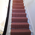 Striped stair carpet with chrome stair rods