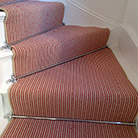 Stair carpets with stair rods