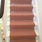Stripe carpet with traditional stair rods in chrome