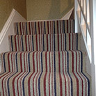 Striped stair carpet installation