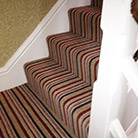 Stripey carpet fitted to stairs
