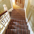 Striped staircase and landing carpet