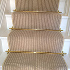 Striped stair Carpet with gold stair rods